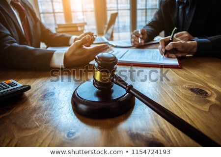 Businessman or lawyer working on a documents, judge gavel with J Stock photo © Freedomz