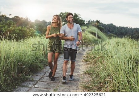Happy in love couple walking in park, people walking at nature hugging each other, leisure time Stock photo © robuart