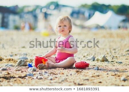 Sand pies at a sea coast Stock photo © dsmsoft