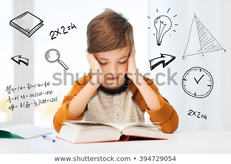 stressed schoolboy studying in classroom stock photo © dacasdo