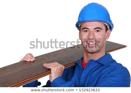 Man slotting laminate, flooring together Stock photo © photography33