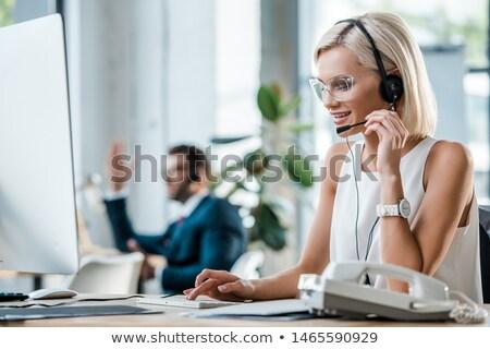 attractive businessman with headset on stock photo © wavebreak_media