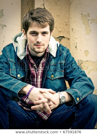 young man wearing only jeans and sitting Stock photo © stepstock