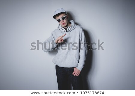 cool man in gray sweatshirt wearing sunglasses and cap with scar Stock photo © feelphotoart