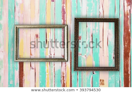 Stock photo: Two  Frames Of Picture On A Striped Old Wall