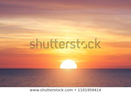 Schilderachtig oranje zonsondergang zee rimpeling Stockfoto © asturianu