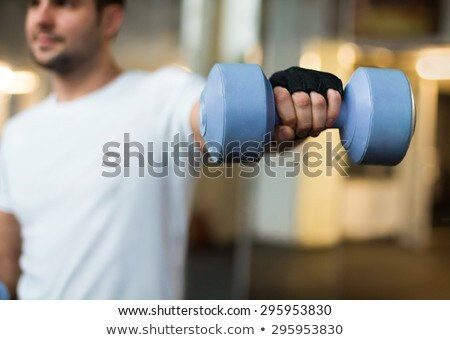 Homens mãos luz azul halteres esportes Foto stock © Yatsenko