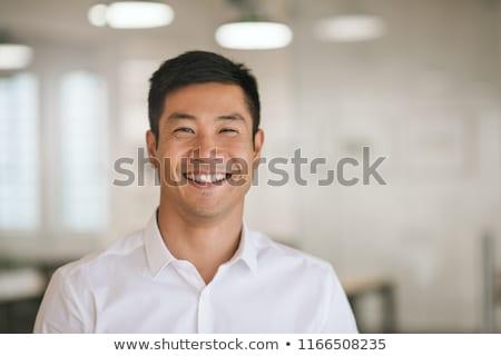 young asian businessman laughing stock photo © rastudio