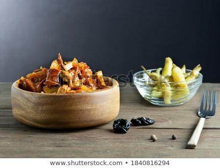 Stewed cabbage with meat on dark rustic wooden background Stock photo © yelenayemchuk