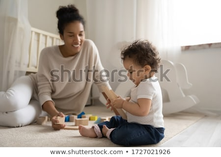 Young girls playing with building blocks Stock photo © IS2