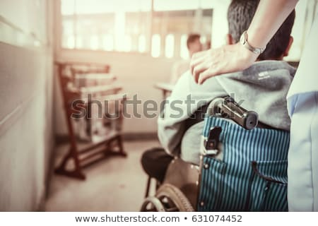 man in wheelchair pushed by children Stock photo © IS2