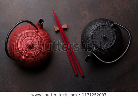 Kırmızı çay pot sushi Çin yemek çubukları demlik Stok fotoğraf © karandaev