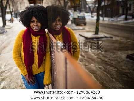 gelukkig · zwarte · vrouw · permanente · straat · reflectie · jonge - stockfoto © Stasia04