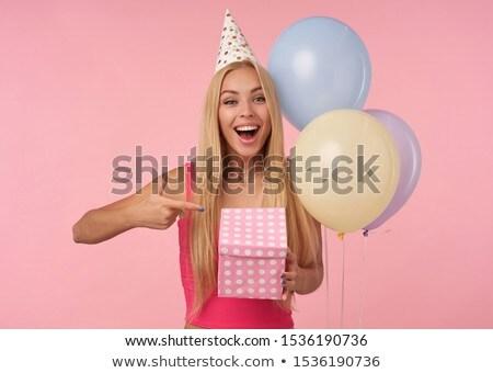 Gyönyörű fiatal érzelmes nő pózol izolált Stock fotó © deandrobot