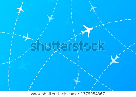 A lot of white planes on dashed traces on blue Stock photo © evgeny89