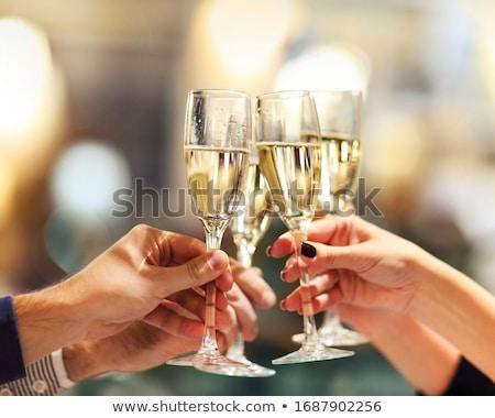 Meninas homem vidro champanhe celebrar ano novo Foto stock © ruslanshramko