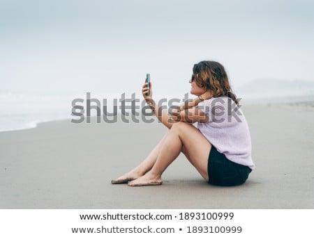young woman laid on the sand Stock photo © photography33