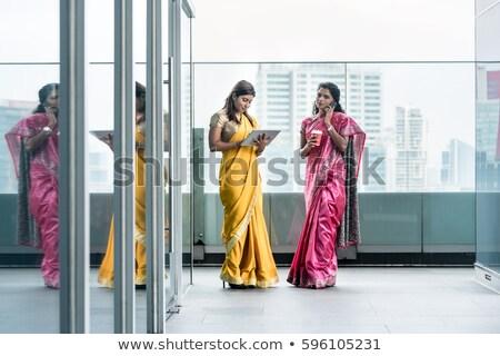 Female in pink sari Stock photo © ziprashantzi