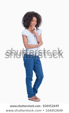 Young woman standing with her finger on chin Stock photo © bmonteny
