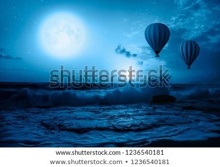 Hot-Air Balloon Floating Against Blue Sky Stock photo © Balefire9
