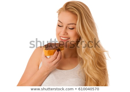 Woman spreading hazelnut nougat cream over bread slice Stock photo © stevanovicigor