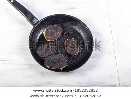 Old rusty frying pan Stock photo © Digifoodstock
