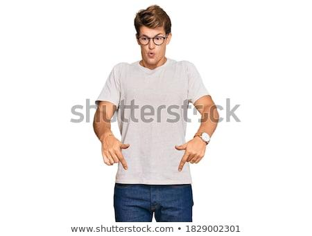 ハンサムな男 ポインティング 画像 立って 孤立した 黄色 ストックフォト © deandrobot
