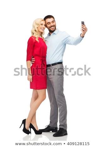Stok fotoğraf: Happy Family Couple Taking Selfie At Christmas