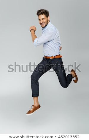 Portret elegante springen man geïsoleerd vent Stockfoto © majdansky