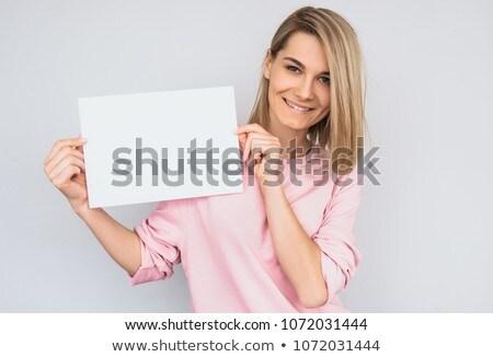Сток-фото: счастливая · девушка · улыбаясь · чистый · лист · бумаги · знак · совета