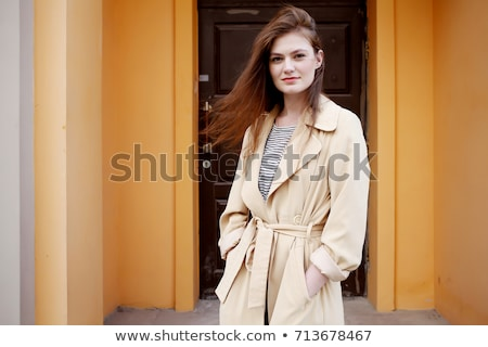 Beautiful young fashion model wearing a trench coat Stock photo © dashapetrenko