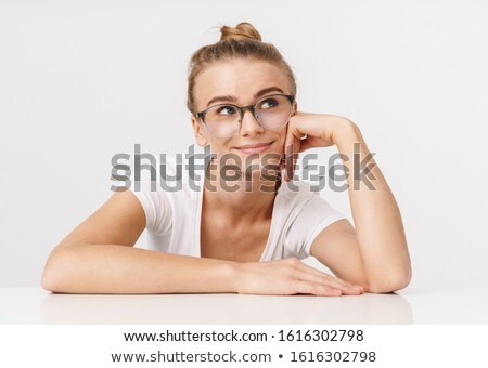 Photo of nice pleased woman smiling while leaning on table Stock photo © deandrobot
