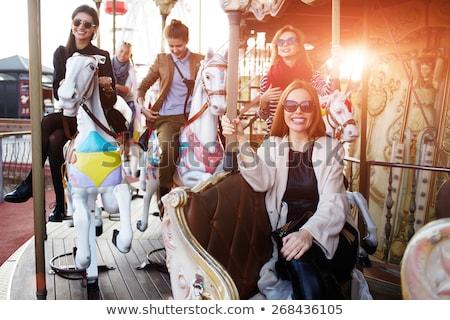 Beautiful, young woman having fun at an amusement park Tourists fear the 2019-ncov virus. Medical ma Stock photo © galitskaya