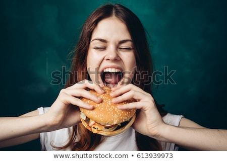 Photo stock: Jeunes · femme · manger · hamburger · fille · heureux