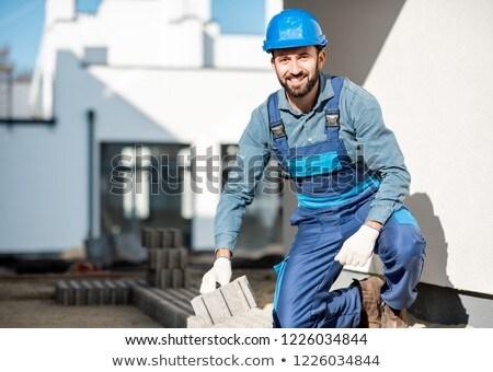 portrait of handyman installing tiles Stock photo © photography33