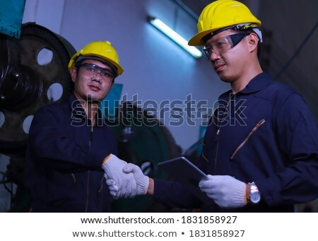 Two manual workers greeting each other Stock photo © photography33