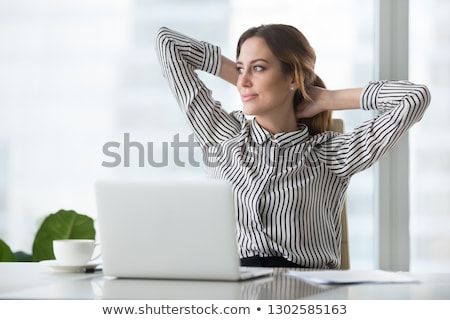 Daydreaming businesswoman Stock photo © aremafoto