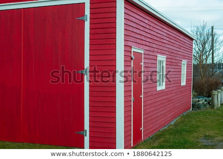 Red building with two small windows Stock photo © mobi68