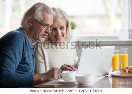 Couple looking at a laptop during breakfast Stock photo © photography33