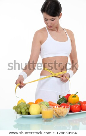 pretty brunette doing sport and eating healthily Stock photo © photography33