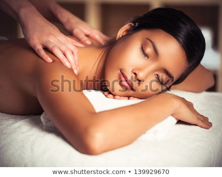 dark haired woman enjoying the relaxation in a spa centre stock photo © wavebreak_media