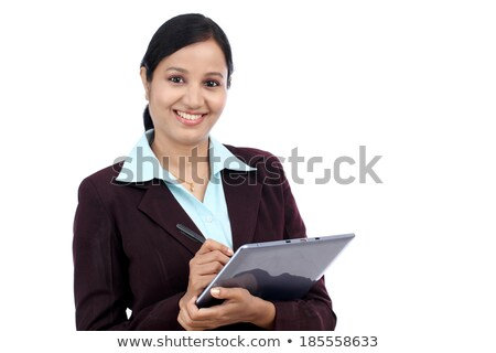 Businesswoman writing on a touch pad against white background stock photo © wavebreak_media