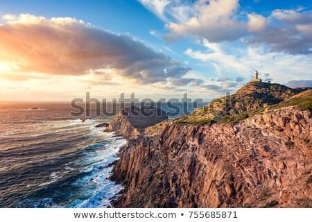 Világítótorony sziget dél nyugat égbolt virág Stock fotó © Antonio-S