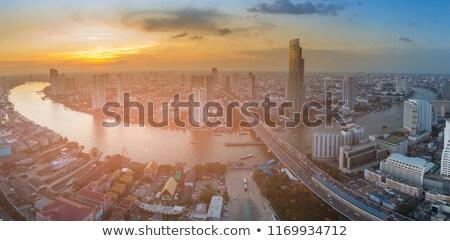 Légifelvétel Bangkok naplemente égbolt épület fény Stock fotó © meinzahn