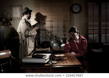 Vintage detective standing in his office Stock photo © stokkete
