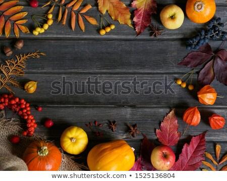 красный яблоки оранжевый старые деревянный стол Сток-фото © saralarys