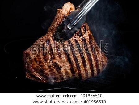 frito · fatias · carne · cebola · temperos · frigideira - foto stock © digifoodstock
