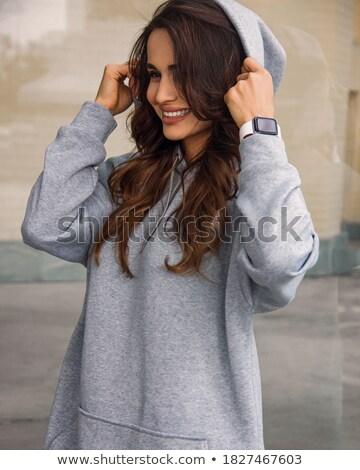 Pretty woman in gray hoody Stock photo © acidgrey