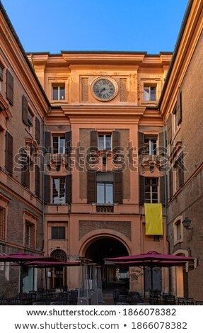 Old clock on the building in Modena, Italy Stock photo © boggy