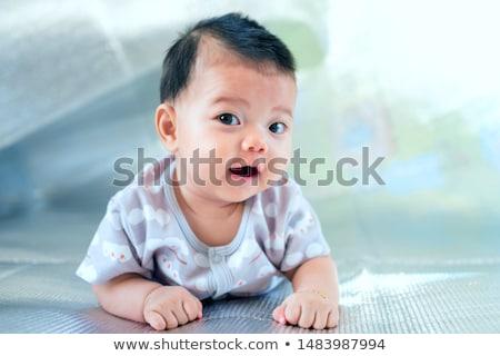 sweet little asian baby boy lying on floor at home Stock photo © dolgachov